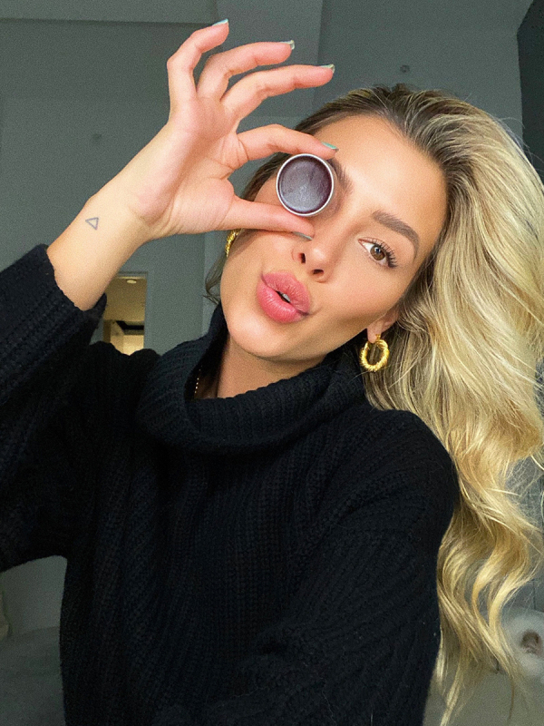 Influencer Michelle holding lip&cheek stain up to her eye