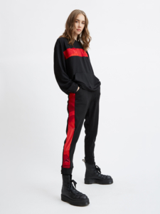 Female model wearing black and red jogger by designer Zero Waste Daniel.