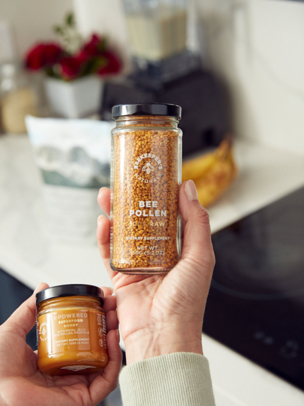 Girl showing the Bee Pollen in the kitchen